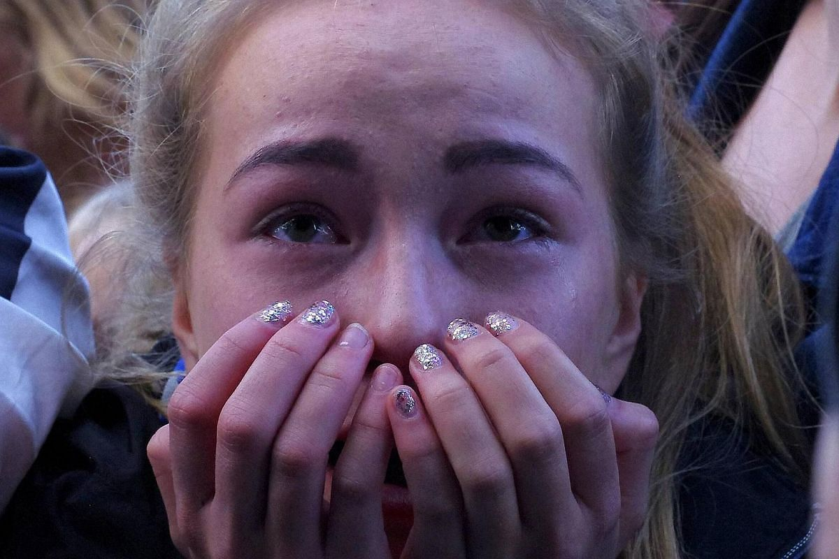 A fan reacts as she celebrates the team returning home after the Euro 2016 in Reykjavik, Iceland.
