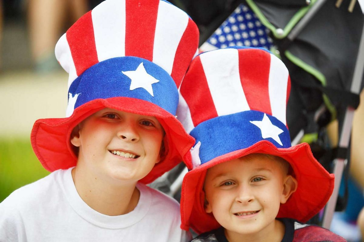 Ian James, 13 and his brother, Dylan, 5, of Fontana, Calif., show their patriotic spirit at the Independence Day parade in Washington, DC.