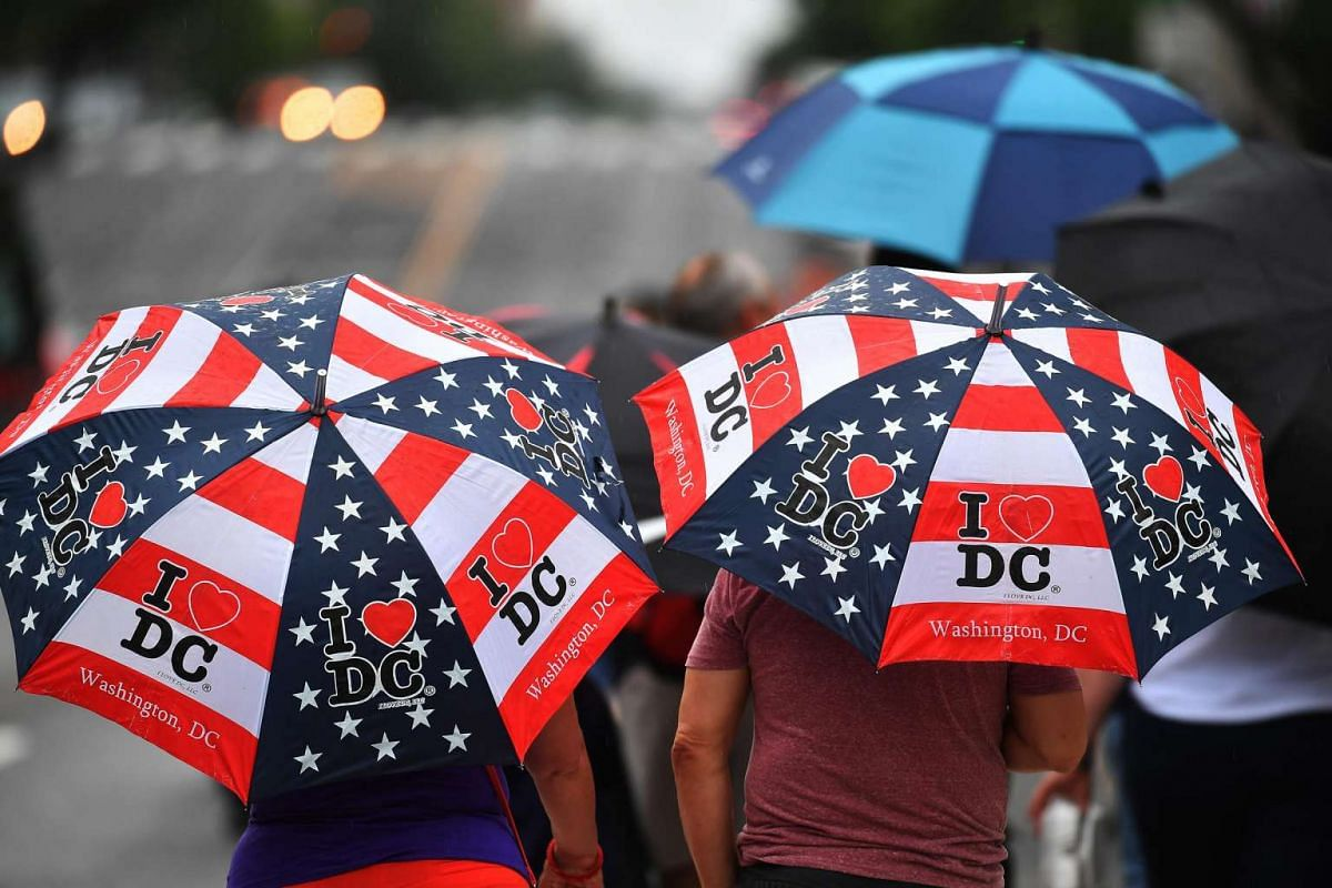 The Independence Day parade ended just as it started to rain on spectators along Constitution Avenue in Washington, DC.