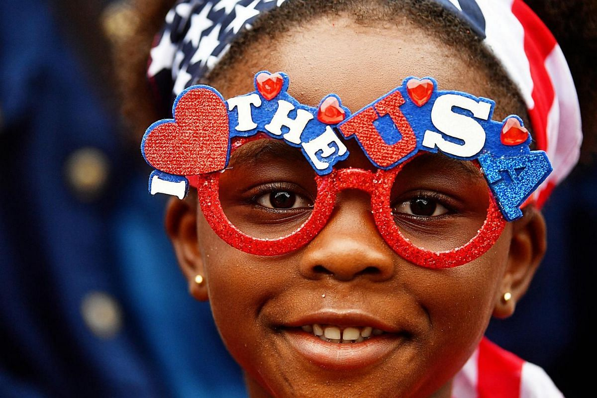 Emily Olatunji, 6 of Frisco,Texas Parkerson and her family watch the Independence Day parade in Washington, DC.