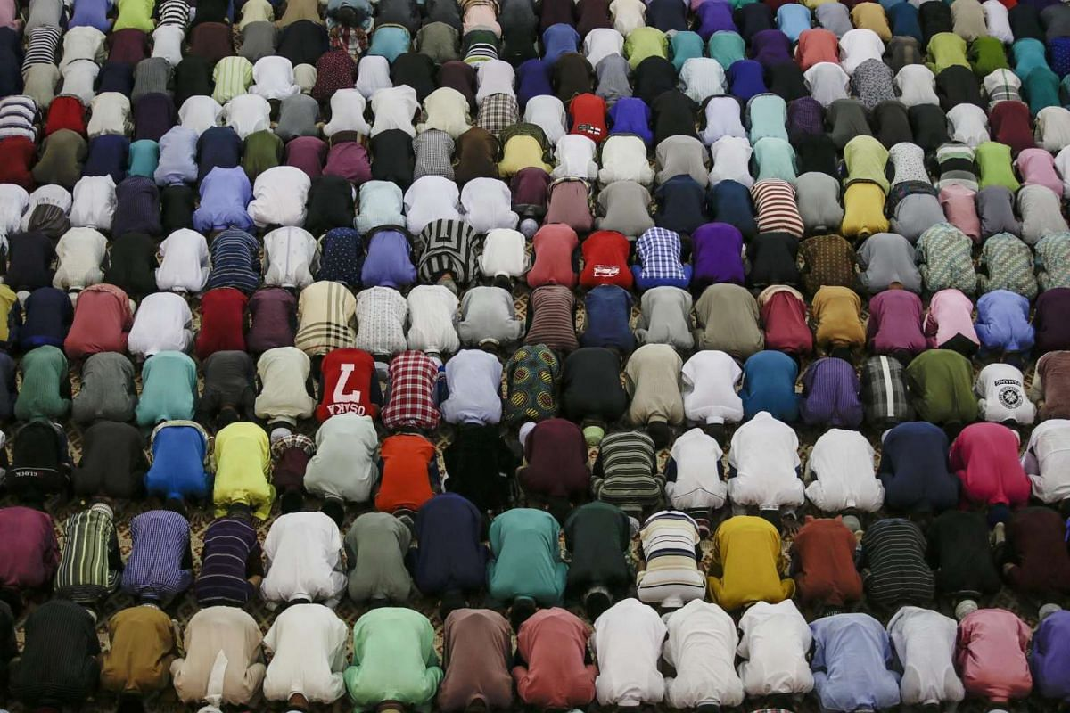 Malaysian Muslims offer Eid al-Fitr prayers at the National mosque in Kuala Lumpur on July 6, 2016.