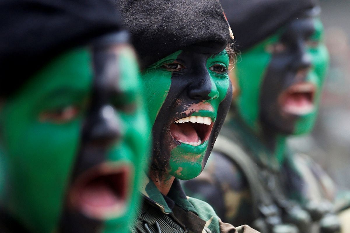 Female soldiers with their faces painted march during a military parade to celebrate the 205th anniversary of Venezuela's independence in Caracas, Venezuela, on July 5, 2016.
