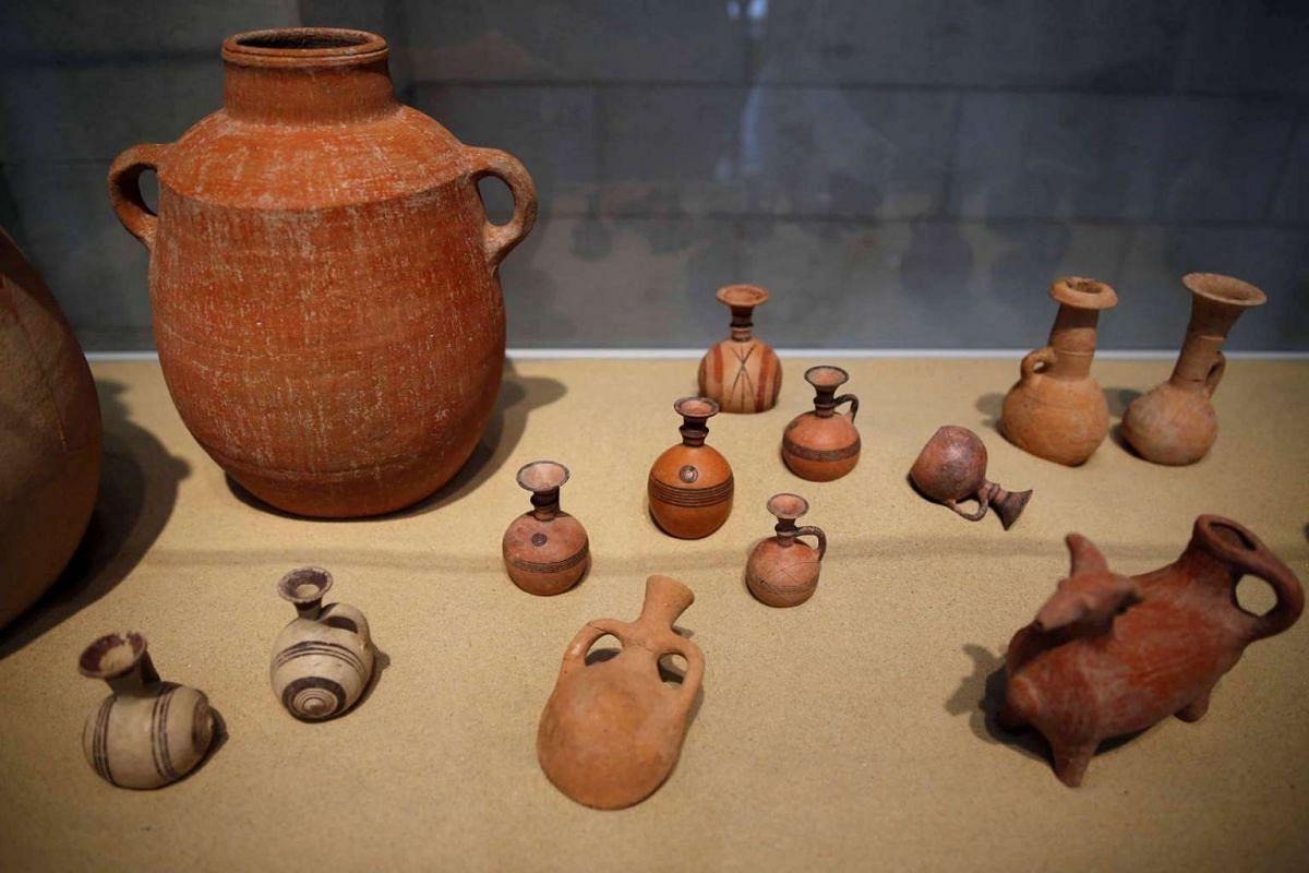 Clay artifcats that were unearthed during an archaeological dig at the Philistine cemetery at Ashkelon National Park, on display at the Rockefeller Museum in Jerusalem on July 6, 2016.