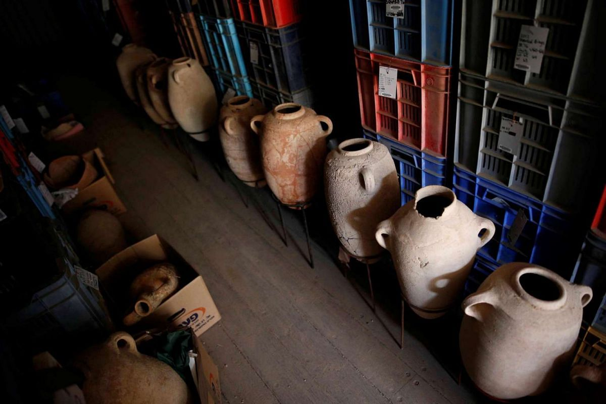 Clay jars are seen after they were unearthed during excavation works at the Philistine cemetery, at Ashkelon National Park in southern Israel, on June 28, 2016.