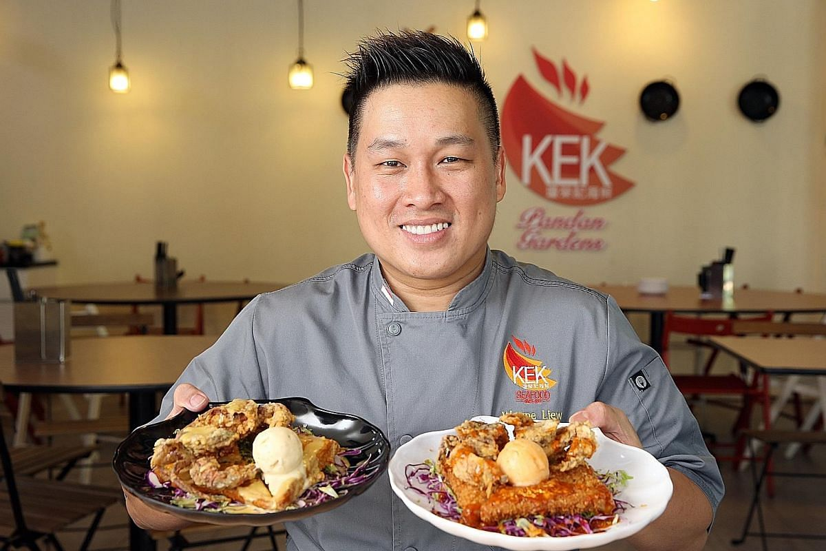 KEK Pandan Gardens' head chef Wayne Liew with his salted egg yolk ice cream with soft shell crab and crispy toast (right) and chilli crab ice cream with soft shell crab and cereal toast (far right). Ms Abby Lim, co-owner of The Quaintest Co that runs