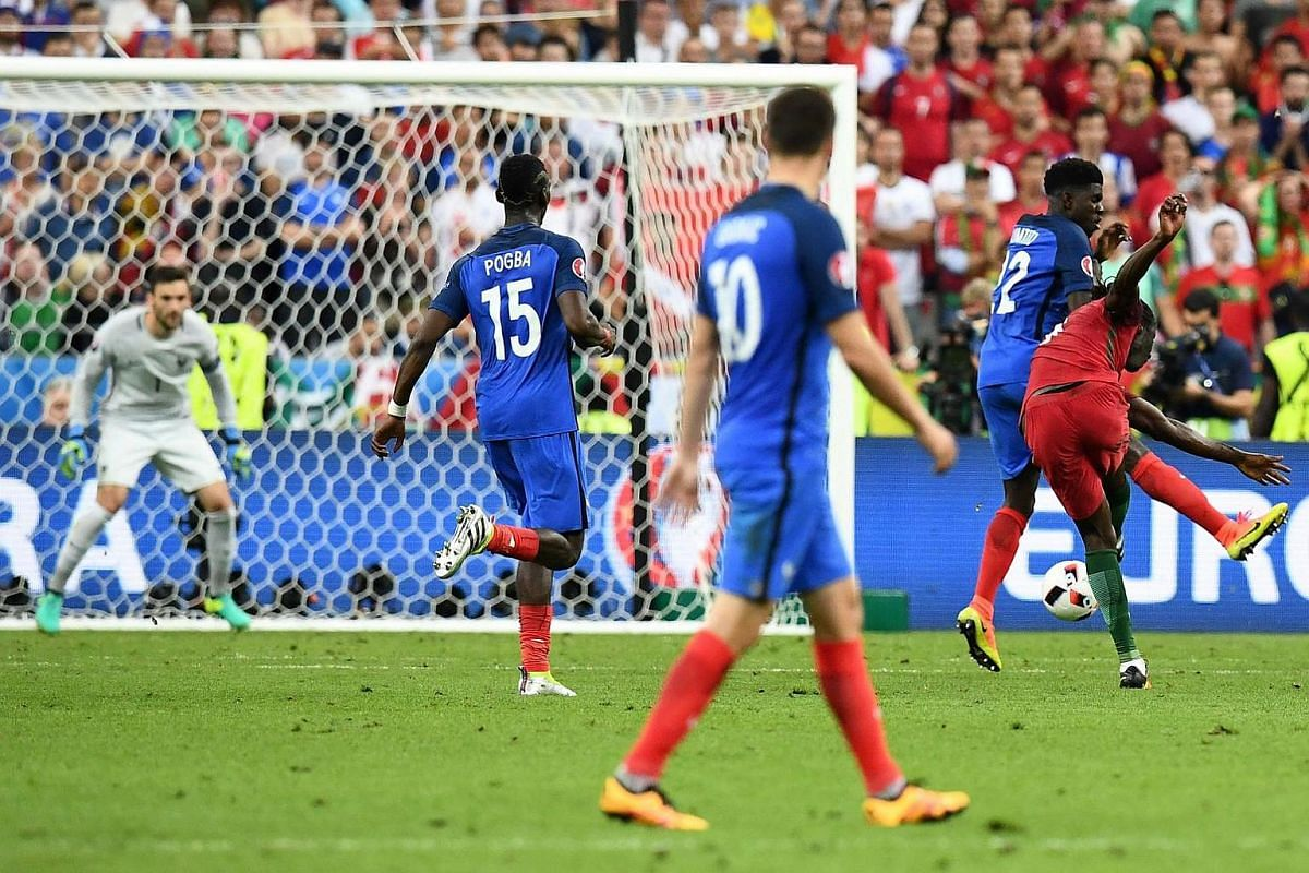 Portugal's forward Eder (right) scores the first goal during the Euro 2016 final football match between France and Portugal.