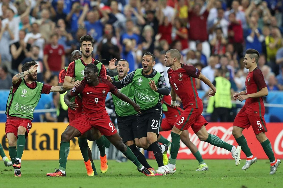 Portugal's forward Eder (third left) celebrates with teammates after scoring a goal during the Euro 2016.