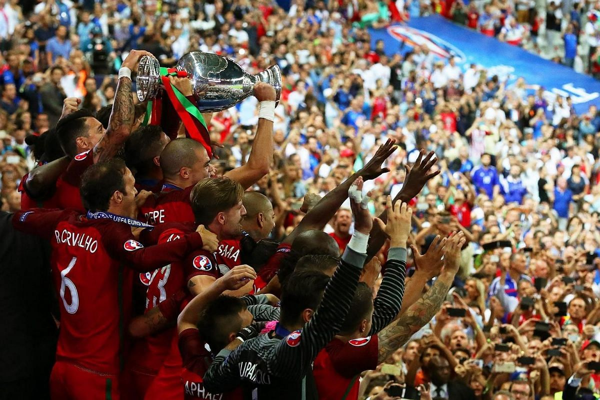 Players of Portugal celebrate with the trophy after winning the Uefa Euro 2016 final match between Portugal and France.