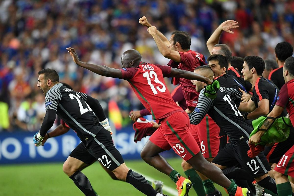 Portugal players celebrate after winning the Uefa Euro 2016 final match between Portugal and France.