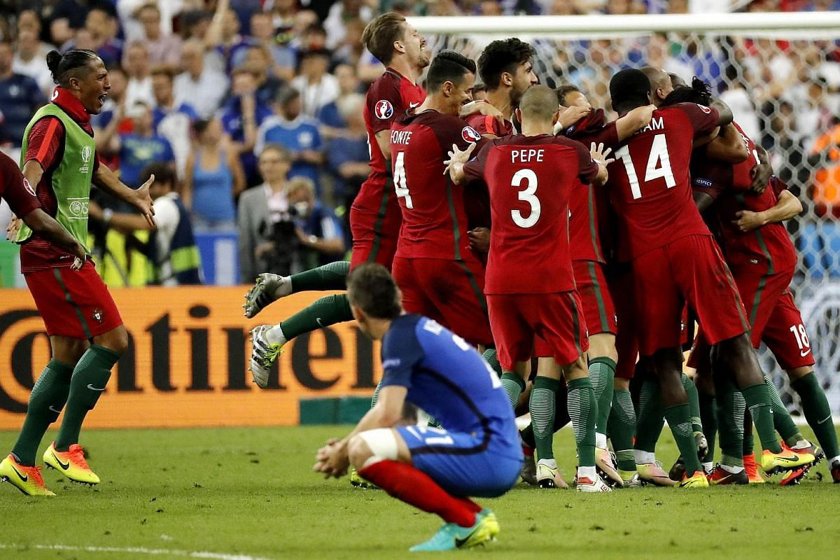 Portugal Players react after winning the Uefa Euro 2016.