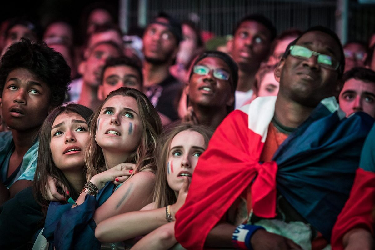 French fans in the Eiffel Tower fan zone react after the Uefa Euro 2016 final match between France and Portugal in Paris, France, on July 10.