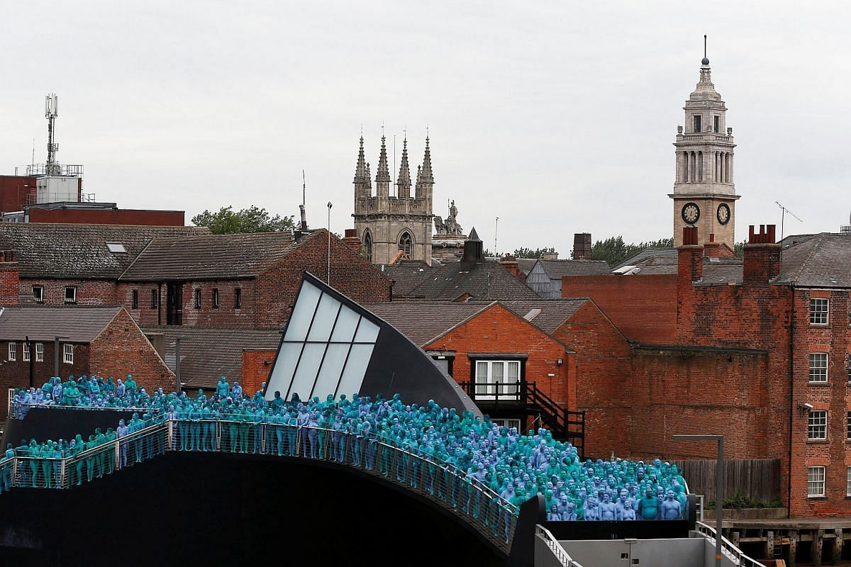 Nude models prepare to pose for a photograph by US artist Spencer Tunick, for a project titled Sea of Hull in Hull city centre, northern England, on July 9.