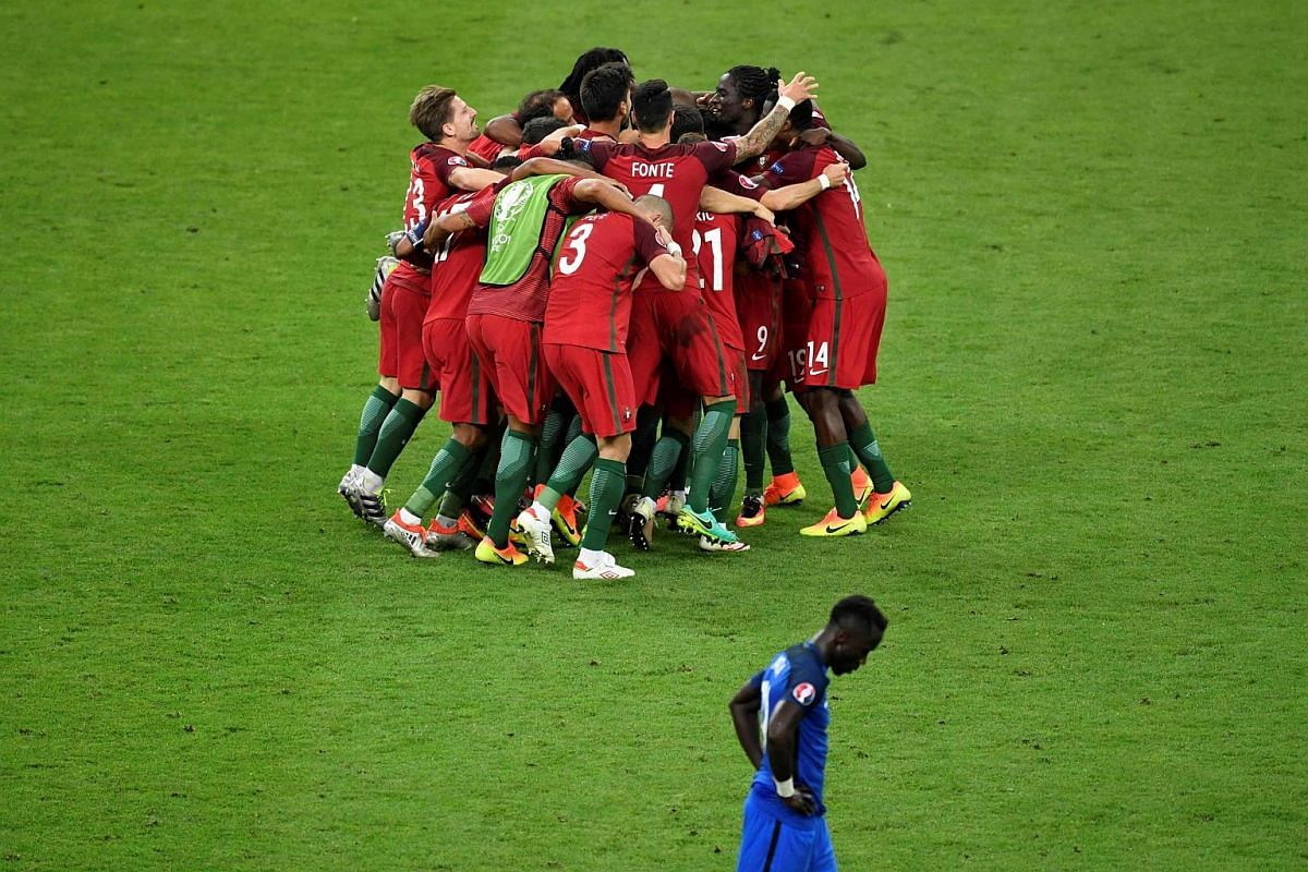 Portugal players celebrate after winning the Euro 2016 final football match between Portugal and France.