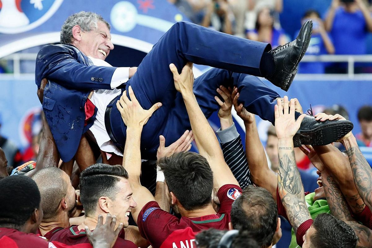 Portuguese coach Fernando Santos is lifted in the air by players after winning the Euro 2016.