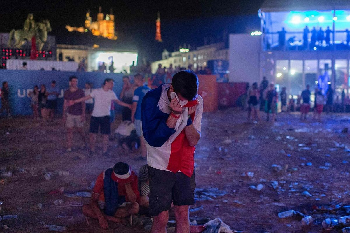 France's supporters react following the Euro 2016 final football match between Portugal and France.