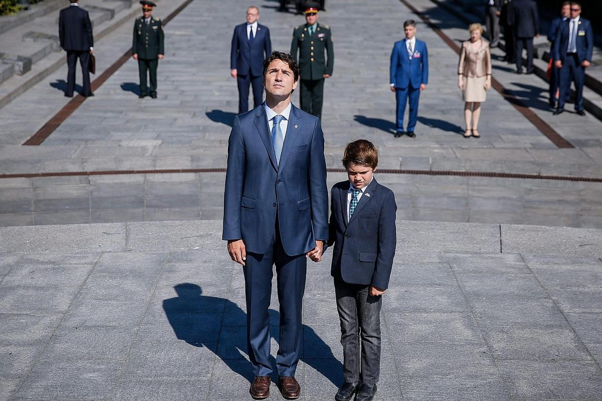 Prime Minister of Canada Justin Trudeau (centre-left) and his son Xavier (centre-right) attend a wreath-laying ceremony at the monument to the Unknown Soldier in Kiev, Ukraine, on July 11.