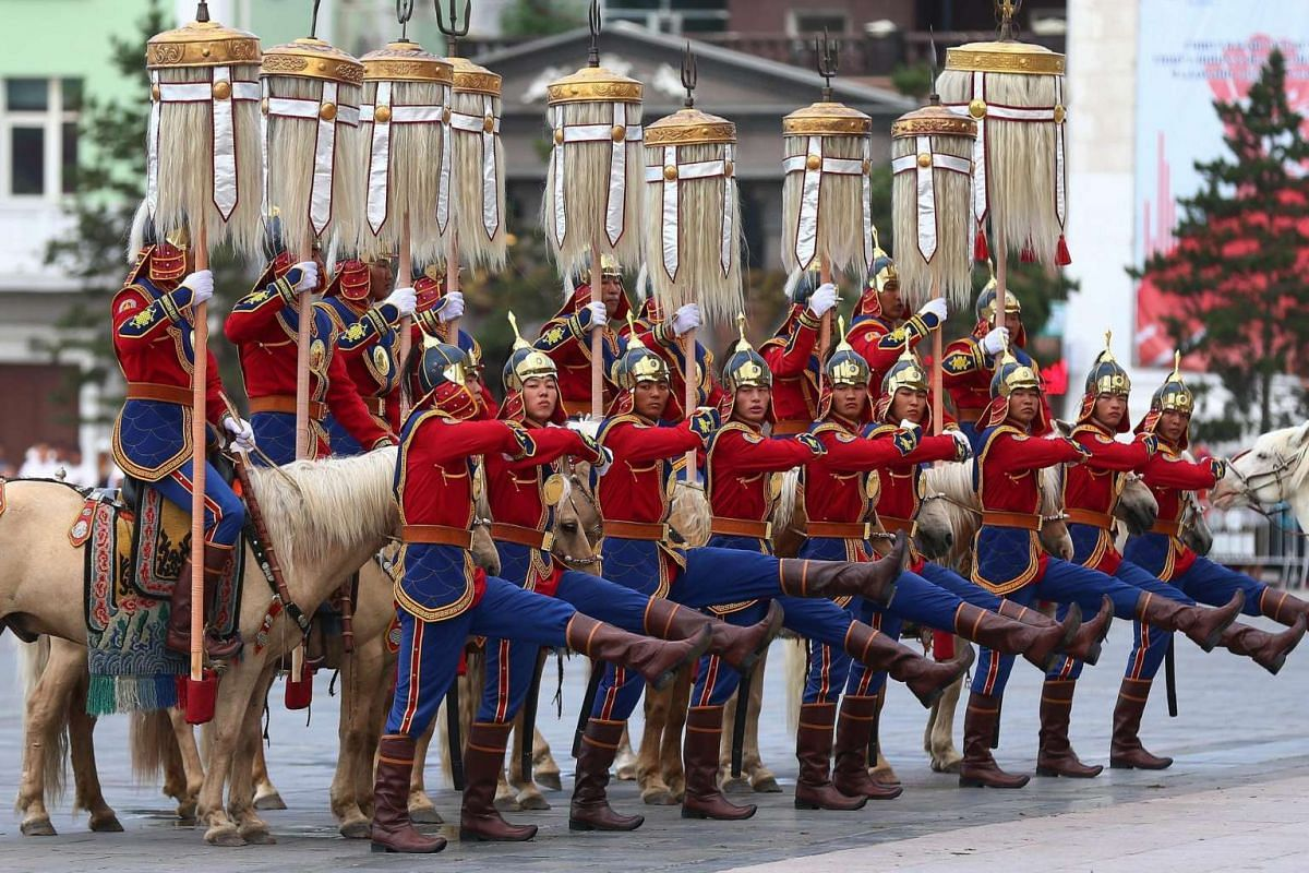 "Honour guards in uniforms carrying the ""Yesun Hult Tsagaan Tug"" (The Nine White Banners) parade from the State Palace to the Central Stadium ahead the opening ceremony of the Naadam Festival in Ulaanbaatar, Mongolia on July 12, 2016."
