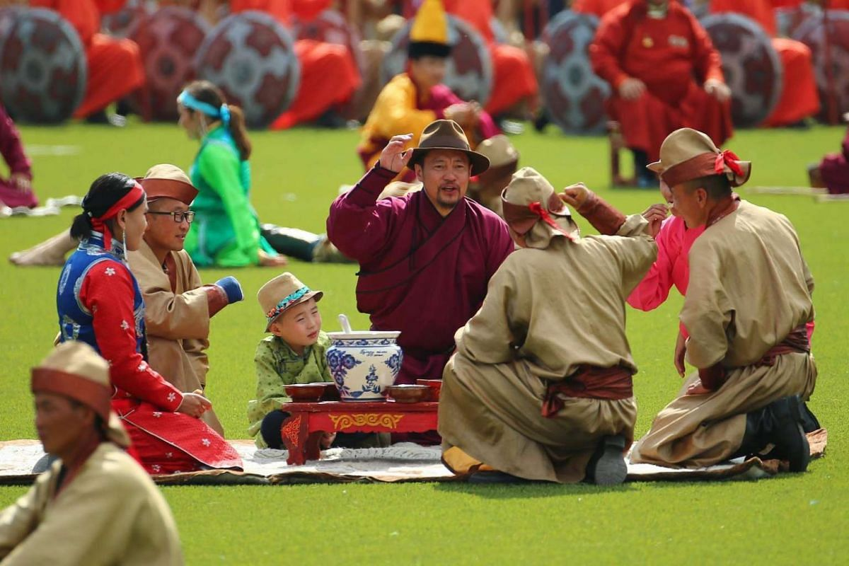 Mongolians perform and display their daily life during the opening ceremony of the Naadam Festival in Ulaanbaatar, Mongolia on July 12, 2016.