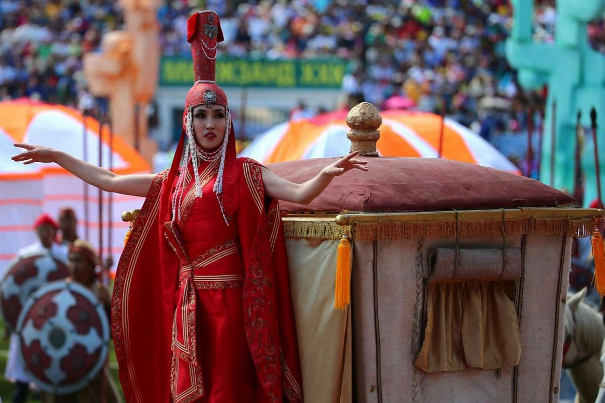 A Mongolian in traditional attire performs during the opening ceremony of the Naadam Festival in Ulaanbaatar, Mongolia on July 12, 2016.