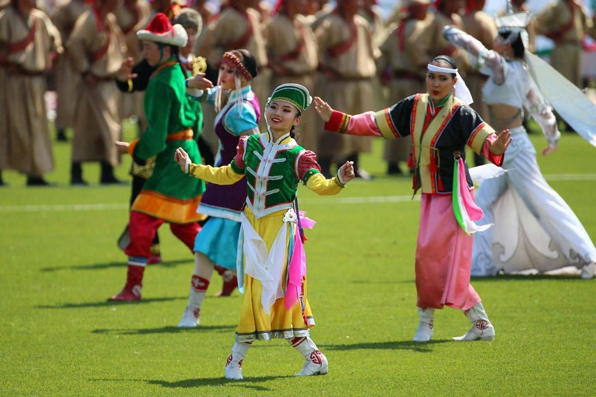 Mongolians in traditional attire perform during the opening ceremony of the Naadam Festival in Ulaanbaatar, Mongolia on July 12, 2016.