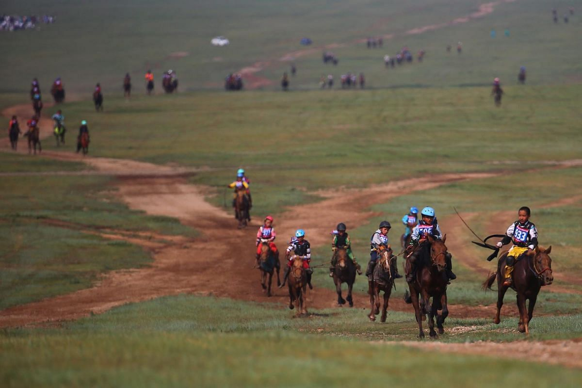 "Mongolian children compete in the ""Soyolon"" (five-year-old horse) horse racing competition during Naadam Festival in Ulaanbaatar, the capital of Mongolia on July 12, 2016."