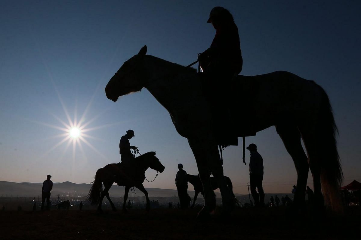 "Horse riders are seen on the horsebacks before the ""Soyolon"" (five-year-old horse) horse racing competition during Naadam Festival in Ulaanbaatar, the capital of Mongolia on July 12, 2016."