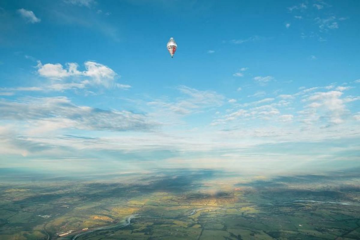 The balloon of Russian adventurer Fedor Konyukhov in the sky during his solo round-the-world balloon flight just after taking off from a spot near Northam, Western Australia on July 12, 2016.