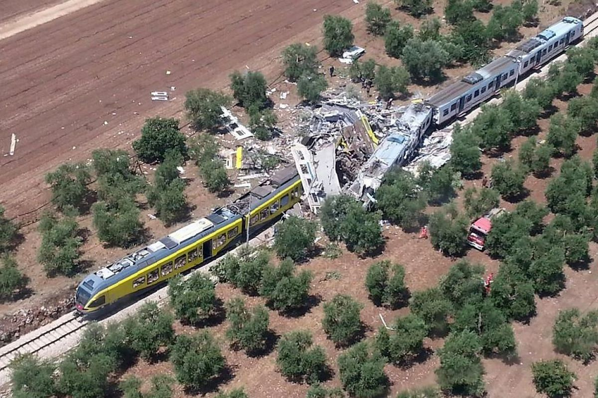 Two smashed carriages thrown across the tracks after a head-on collision between two trains between Ruvo and Corato, in the southern Italian region of Puglia  on July 12, 2016.