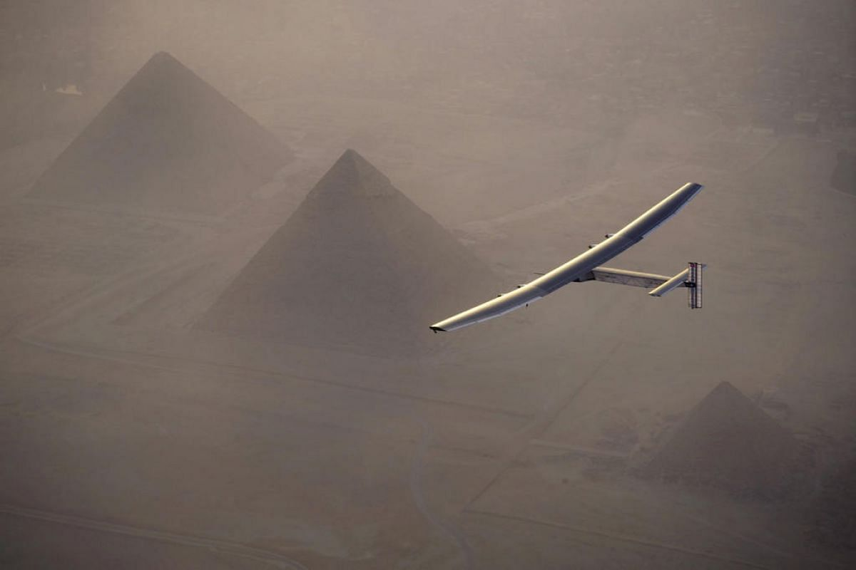 Solar Impulse 2, the solar powered plane, piloted by Swiss pioneer Andre Borschberg during the flyover of the pyramids of Giza prior to the landing in Cairo, Egypt on July 13, 2016.