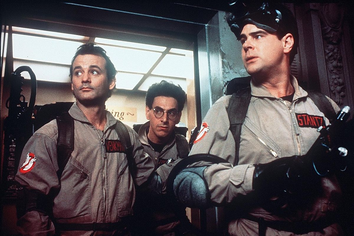 The new Ghostbusters' Melissa McCarthy, Kate McKinnon, Kristen Wiig and Leslie Jones; and the old Ghostbusters' (from far left) Bill Murray, Harold Ramis and Dan Aykroyd.