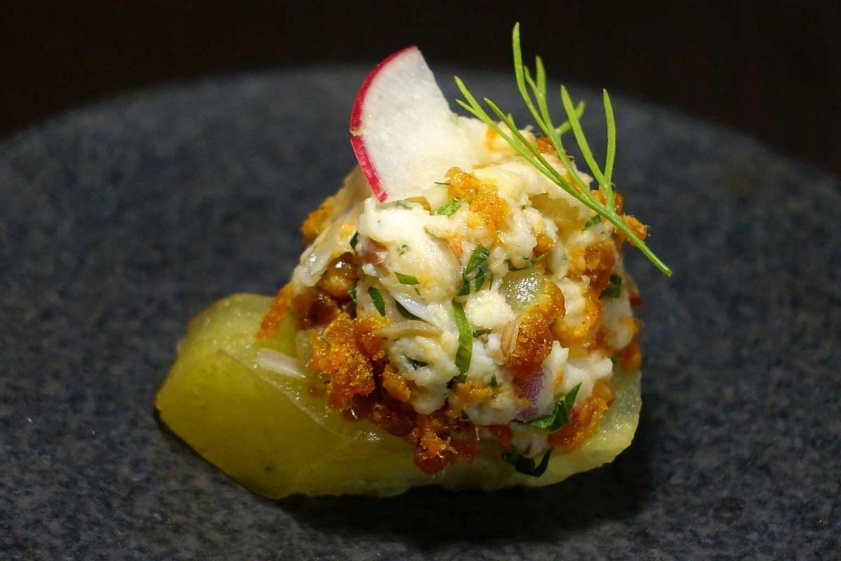 Tumbuk Praws with Sambal Hae Bi on Starfruit from Candlenut.