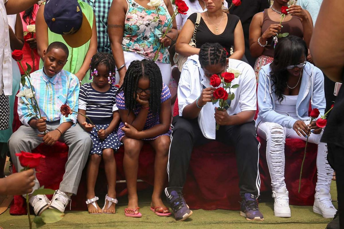 Family members of Delrawn Small, a 37-year-old unarmed black male who was shot dead by an off-duty police officer in Brooklyn, New York on July 4, attend his burial at the Rosehill Cemetery in Linden, New Jersey, on July 13, 2016.