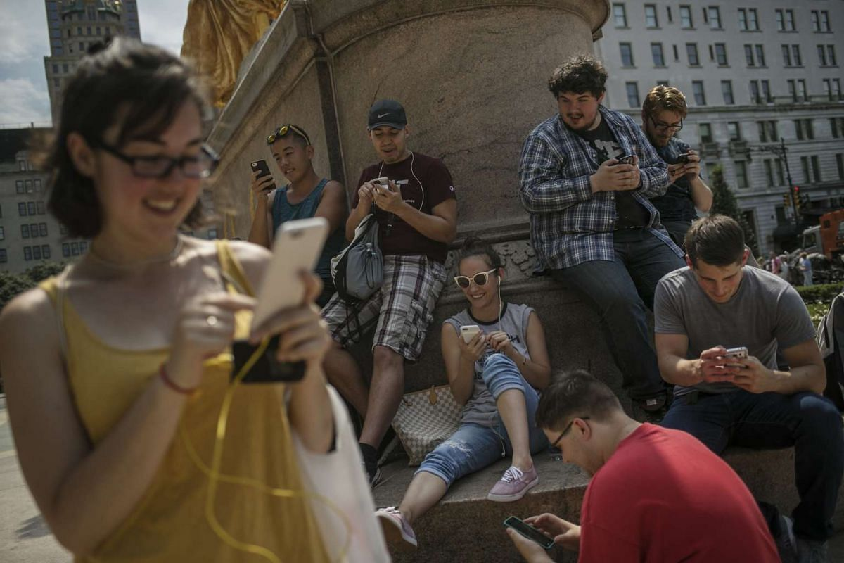 Gamers play Pokemon Go game on Fifth Avenue in New York, on Wednesday, July 13, 2016.