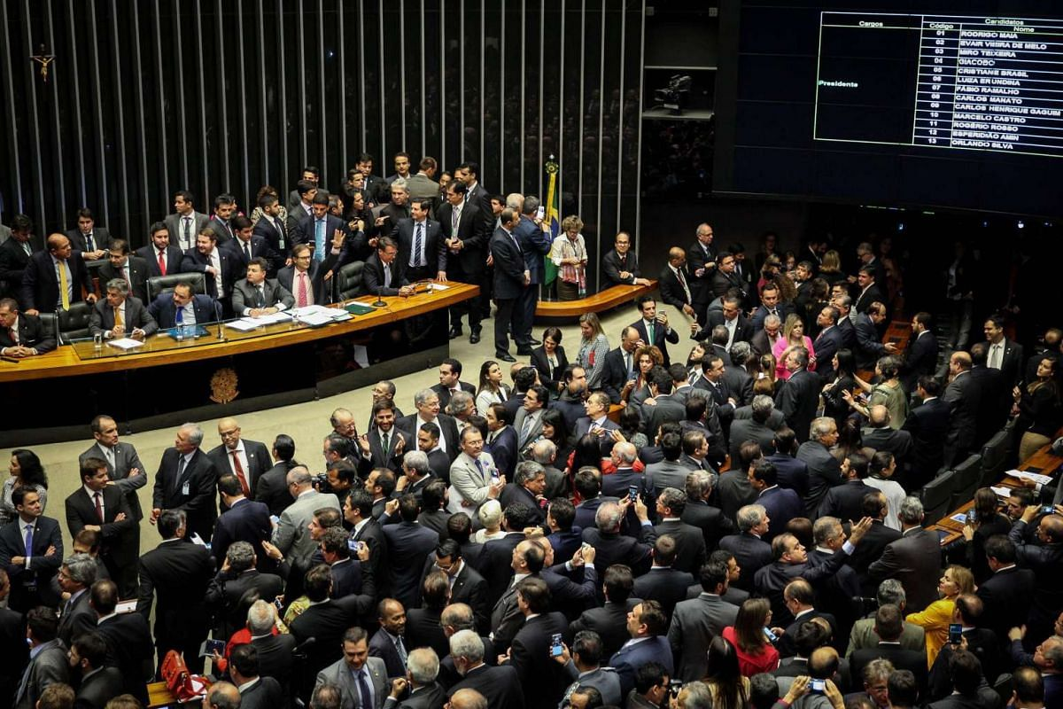 Legislators attend a session of the Chamber of Deputies, during which Democratic Party (DEM) member Rodrigo Maia was elected as Speaker, in Brasilia, Brazil, on July 13, 2016.