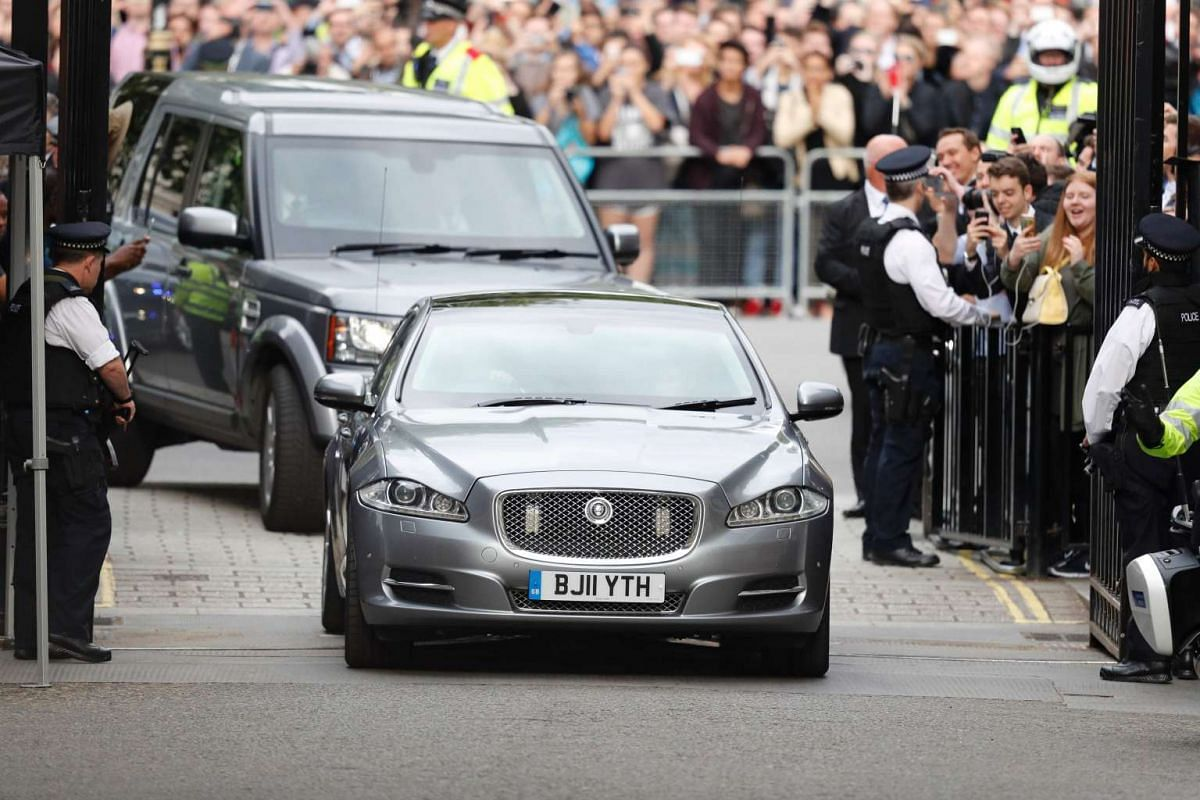 The car of new prime minister Theresa May passes through crowds on the streets of London enroute to her new home at 10 Downing Street.
