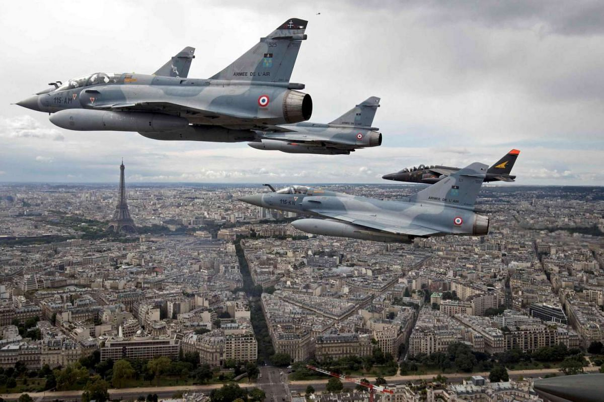 Four Mirage 2000C and one Alpha jet fly over Paris, France, on their way to participate in the Bastille Day military parade, on July 14 2016.