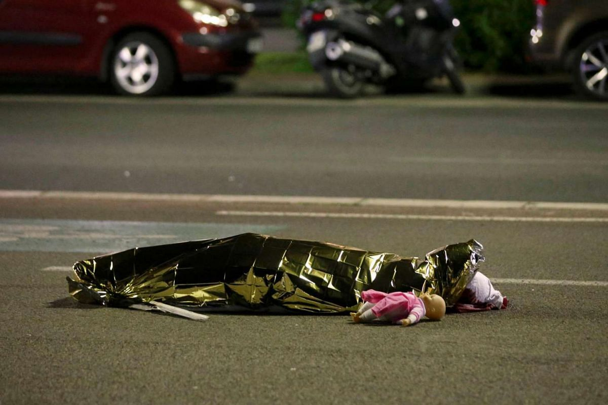 A body lies on the ground on July 15, 2016, after at least 30 people were killed in Nice, France, when a truck ran into a crowd celebrating the Bastille Day national holiday on July 14.