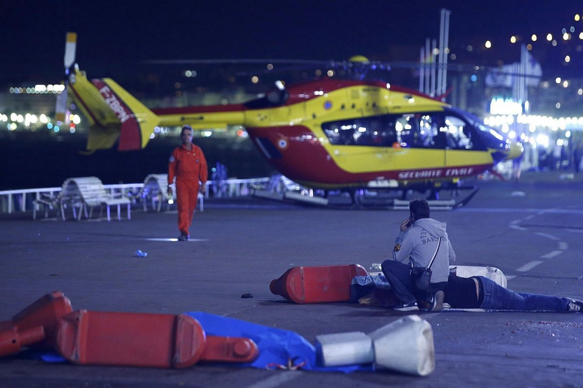 An injured individual is seen on the ground after the attack.