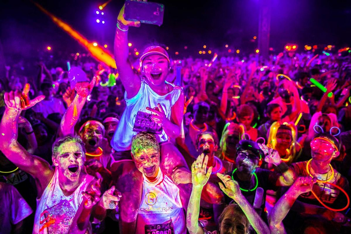 You will get a glow after the Skechers Blacklight Run Singapore, and it is not just from exercising.