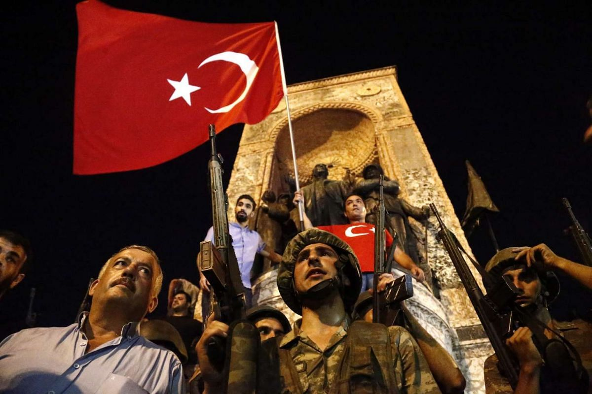 Turkish soldiers stand guard at the Taksim Square in Istanbul, Turkey on July 16.
