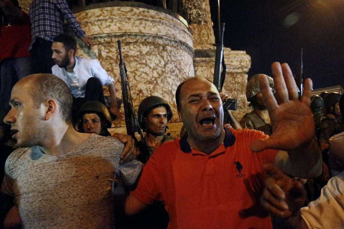 Supporters of President of Turkey Recep Tayyup Erdogan shout slogans at the Taksim Square in Istanbul, Turkey on July 16.