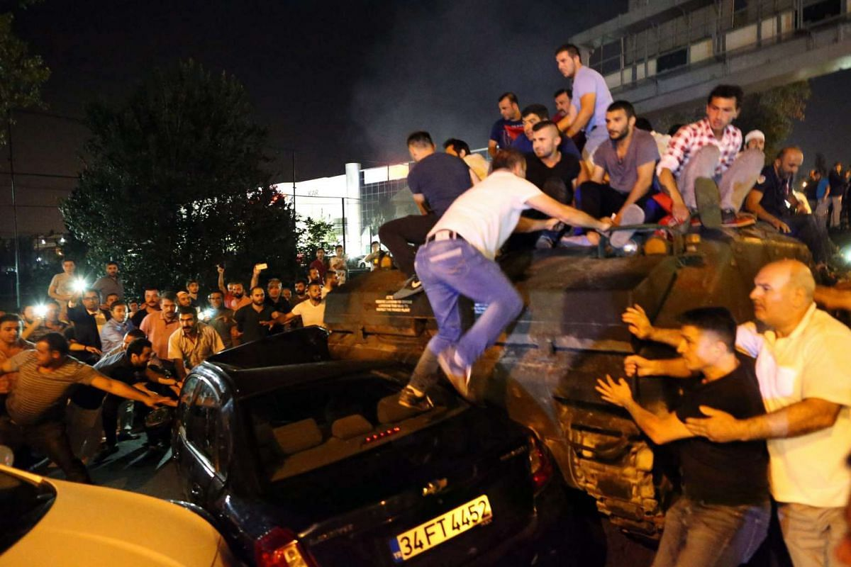 People occupy a tank in Istanbul, Turkey on July 16.