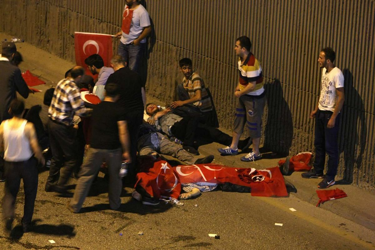 People attend to the wounded in Ankara, Turkey on July 16.
