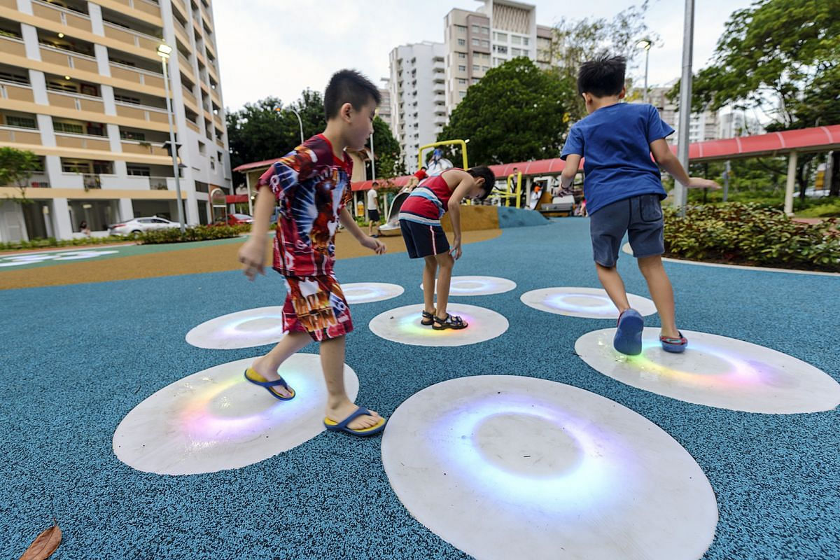 At the Yishun River Green playground, there is a swingset  with seats at different heights and an art installation with pads (above) that light up and change colour when children step on them.