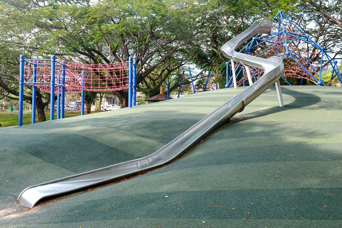 Part-time English teacher Laura Connelly and her two daughters at the Pasir Ris Park playground, which has a 10m-long slide (above).