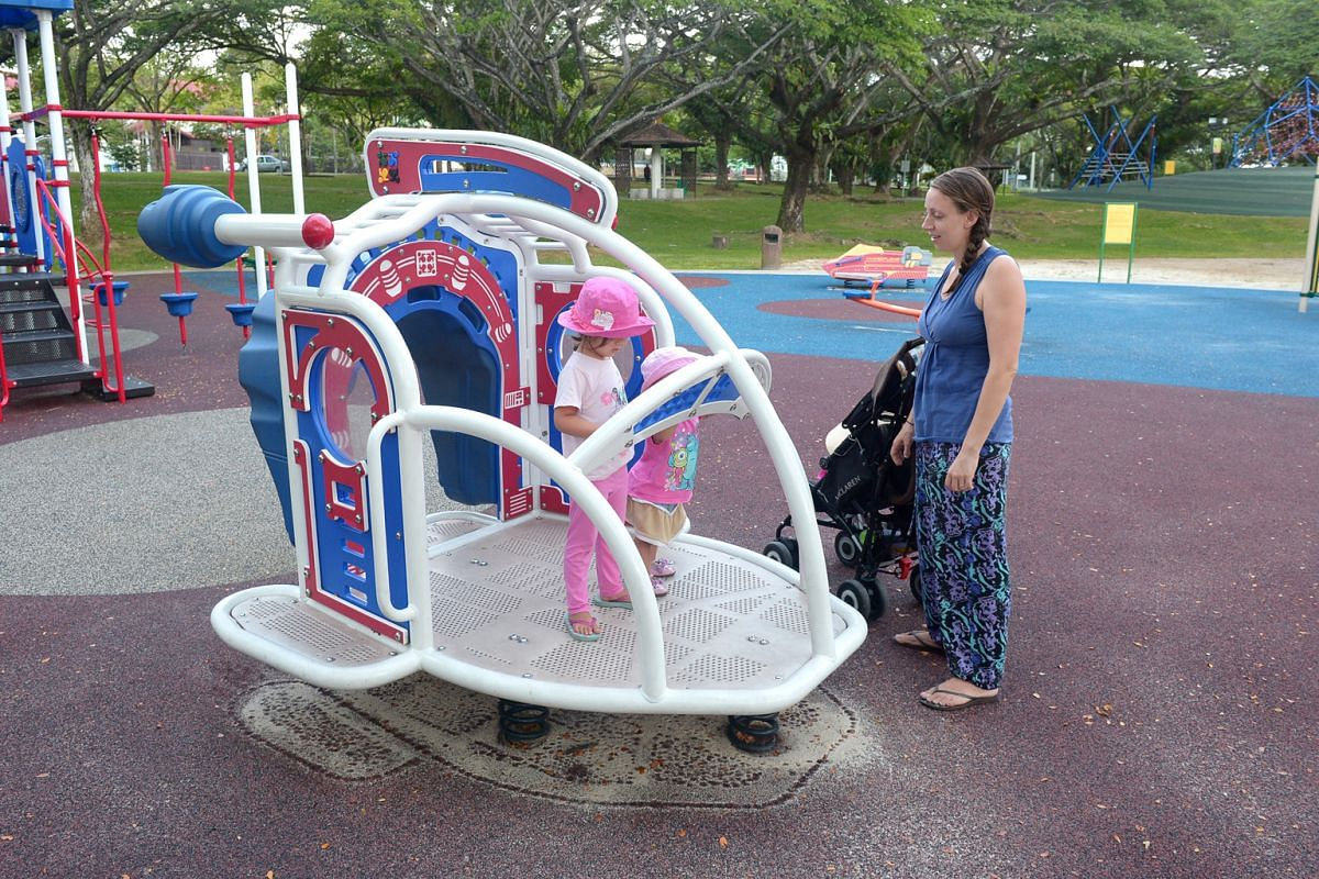 Part-time English teacher Laura Connelly and her two daughters (above) at the Pasir Ris Park playground, which has a 10m-long slide.