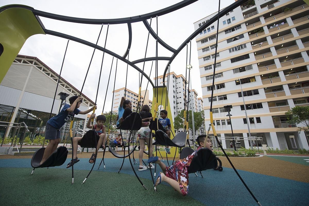 At the Yishun River Green playground, there is a swingset (above) with seats at different heights and an art installation with pads that light up and change colour when children step on them.