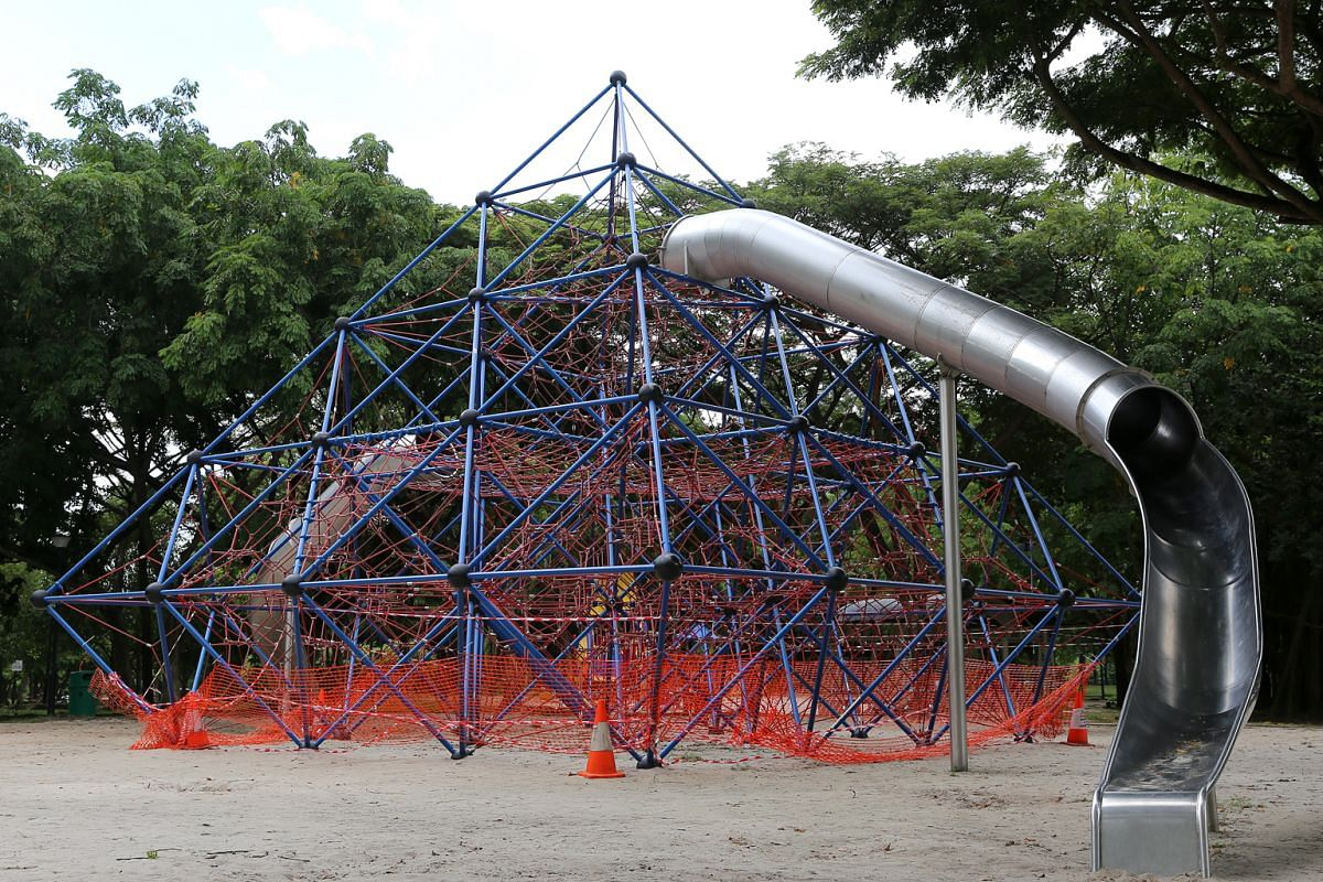 Four-year-old Lucas Au on the flying fox at the West Coast Park playground, which also has a giant rope pyramid (above).