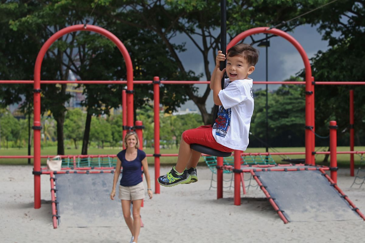 Four-year-old Lucas Au (above) on the flying fox at the West Coast Park playground, which also has a giant rope pyramid.