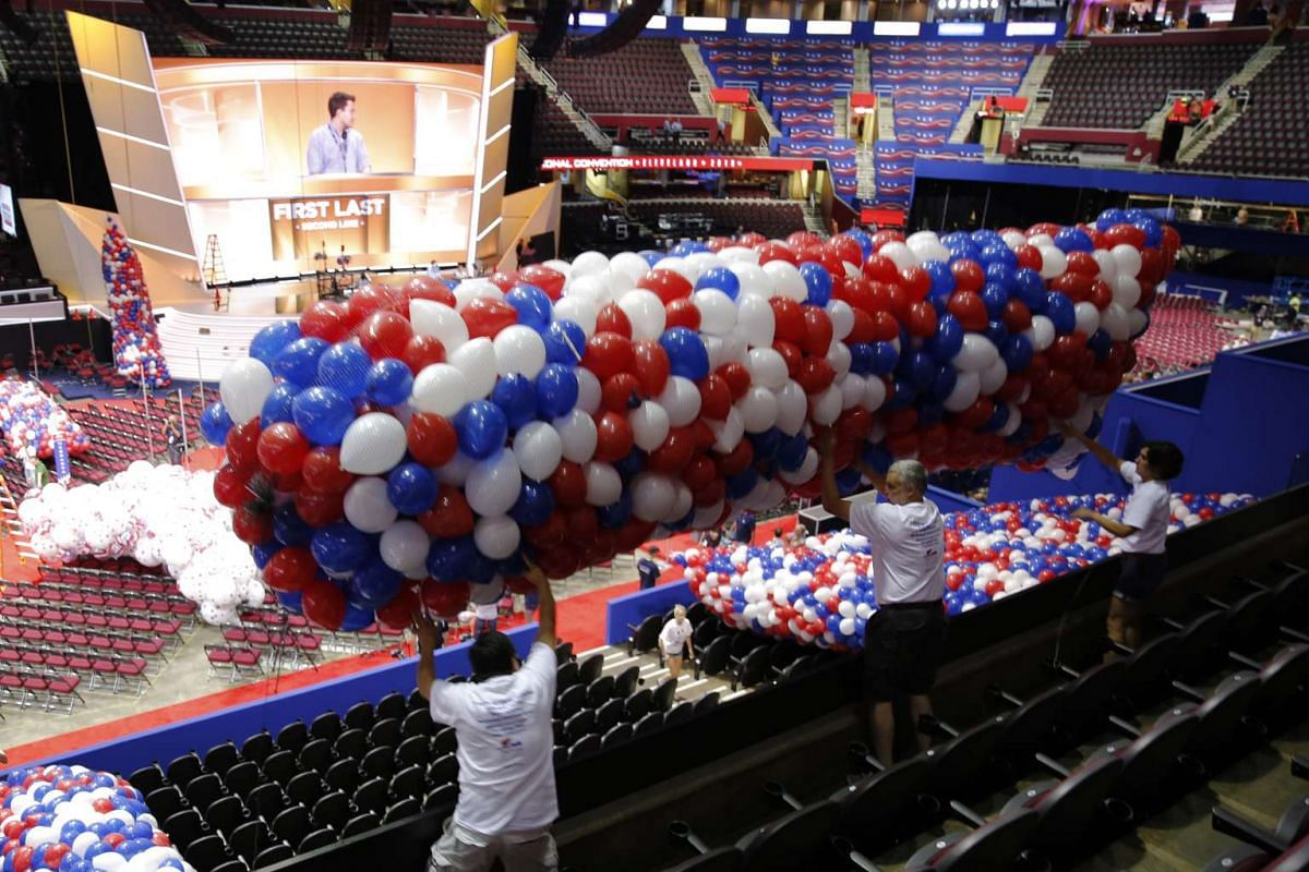 Volunteers move balloons to the floor of the Quicken Loans Arena on July 15, 2016, as workers prepare for the arrival of visitors and delegates for the Republican National Convention.